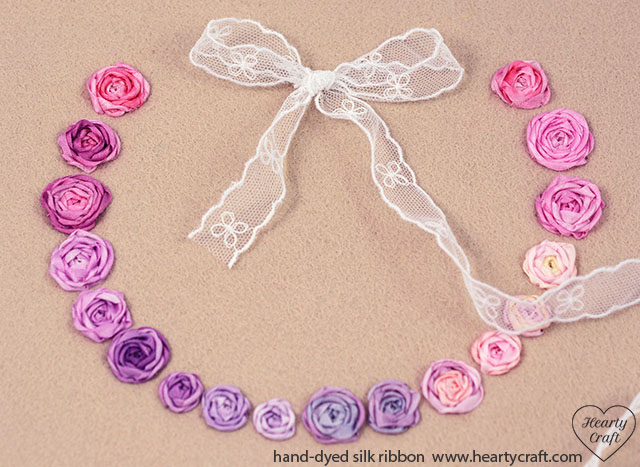 5. Make a bow using wider ribbon and attach it to the felt with sewing floss.