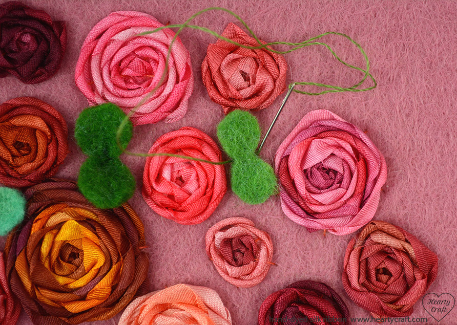 Attaching leaves cushion with ribbon roses tutorial