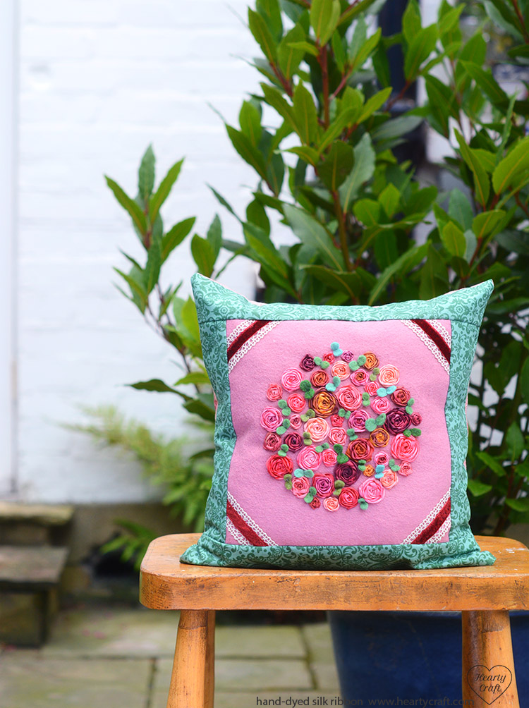 Cushion with ribbon roses
