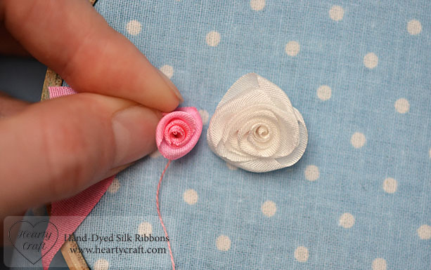 Two Folded Ribbon Roses